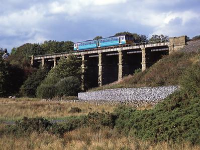 A class 142 DMU crosses Clapham viaduct with a Leeds-Morecambe service 24/9/06.