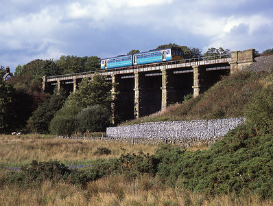 A class 142 DMU crosses Clapham viaduct with a Leeds-Morecambe service 24/9/06.