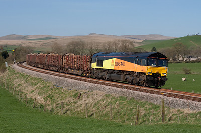 66845 departs Hellifield towards Clitheroe with the Carlisle-Chirk logs 8/4/11.