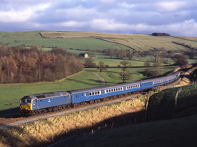 47709 and 47712 top and tail a Skipton-Preston Blue Pullman empty stock working at Eldroth 16/12/06.