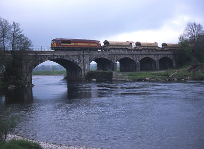 A very rare sight on the Little North Western on 8/5/02 was 56119 with a ballast train, seen crossing the river Lune at Arkholme.