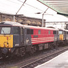 """87033 Thane of Fife and 87005 City of London stand on """"Bertie Road"""" at Carlisle waiting to take over Scottish bound services that have been diverted over the S&C, 9/2/2002."""