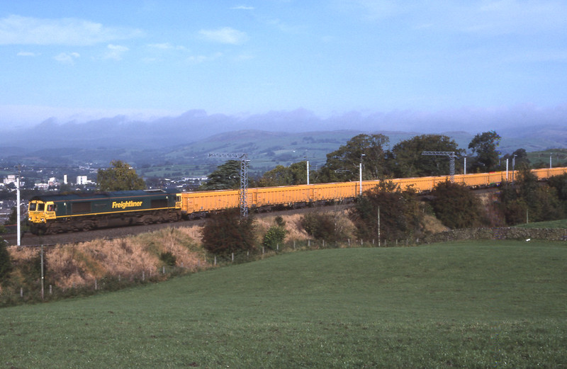 66618 approaches Oxenholme with the Carlisle - Bassford Hall empty ballast boxes, 7/10/2010.