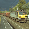92006 Louis Armand passes Oxenholme under heavy skies with the Mossend-Warrington loaded timber, 25/10/2000.