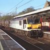92004 Jane Austen passes Oxenholme with a short 6O12 Mossend-Eastleigh enterprise, 18/4/2001.