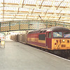 56051 passes through platform3 at Carlisle with the Carlisle Yard to Tees Dock Hoyer train, 5/4/2002.