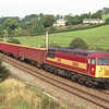 56062 approaches Oxenholme with a loaded timber train, 1/9/2000.