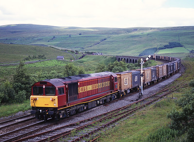 58049 passes Garsdale with the empty gypsum containers on 14/7/98.