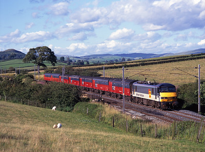 90023 hauls the evening Glasgow-Bristol mail train past Well Heads on 24/7/98.