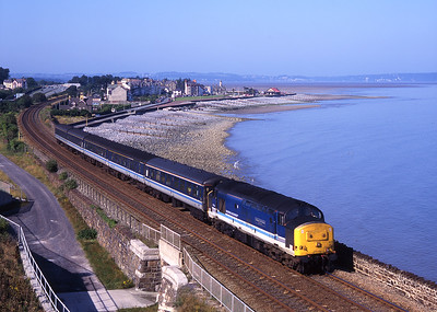 "37414 ""Cathays C&W Works"" passes Llanfairfechan with an eastbound train on 9/8/98."