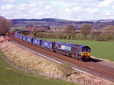 66424 hauls a diverted Tesco train at Portrack 11/4/09.