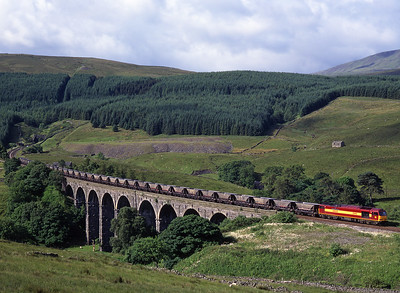 60045 crosses Dent Head viaduct with coal empties on 11/7/98.
