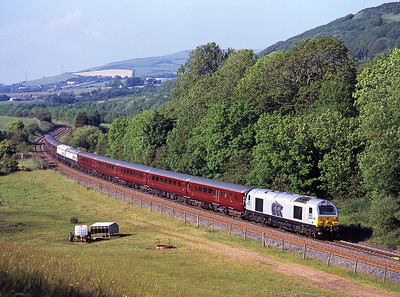 """The empty stock of the annual """"3 Peaks"""" charter approaches Park South behind 67029 on 8/6/07."""