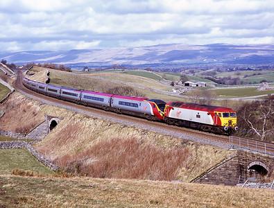 57312 hauls 390037 on a diverted Glasgow-Euston service past Birkett Common 30/3/08.