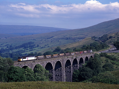 56079 crosses Dent Head viaduct with another engineers train on Sunday 11/7/99.