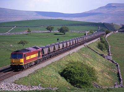 60030 heads north at Waitby with coal empties on 3/5/99.