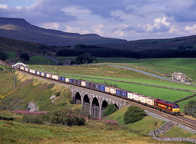 60004 hauls gypsum containers over Lunds viaduct on 30/8/97.