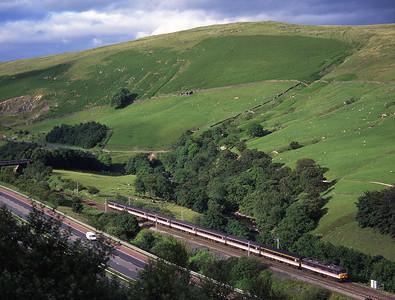 An unidentified 86/2 passes Dillicar with a Glasgow-Paddington train on 5/7/98.
