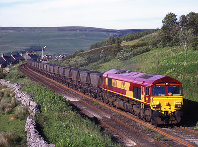 Shiny new 66026 passes Garsdale with a coal train on 16/6/99.