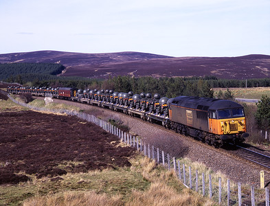 The second of 2 military specials passes Tomatin behind 56112 on 11/5/98.