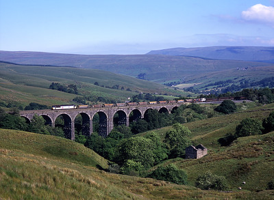 56040 crosses Dent Head viaduct with an engineers train on Sunday 11/7/99.