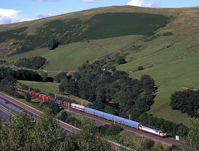 92003 heads south from Tebay with a lengthy Enterprise freight on 24/7/98.