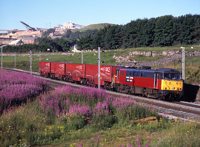 86424 passes Shap Beck with Parcel Force trailers on 27/7/99.