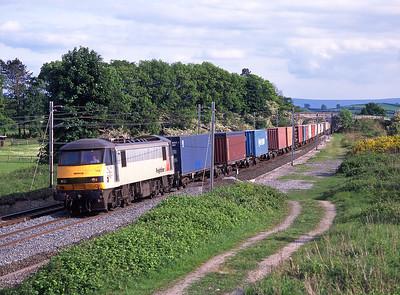 90149 hauls the Felixstowe-Coatbridge liner past Elmsfield on 21/5/98/