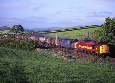 37797 + 37198 haul the china clay tanks past Well Heads on 10/5/99.