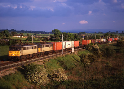 86602 + 86614 pass Elmsfield with a northbound liner train on 27/5/98.