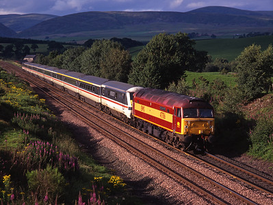 "47786 ""Roy Castle OBE"" passes Closeburn with a Glasgow-Euston train on 1/8/98 with 87024 on the rear."