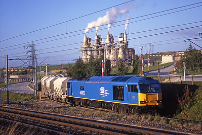 "60033 ""British Steel Express"" shunts limestone empties at Hardendale on 9/9/97."