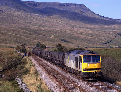 """60014 """"Alexander Fleming"""" toils up to Ais Gill summit with a heavy coal train on 20/9/97."""