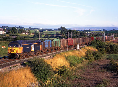 """56074 """"Kellingley Colliery"""" passes Elmsfield with a northbound enterprise freight on 28/7/99."""