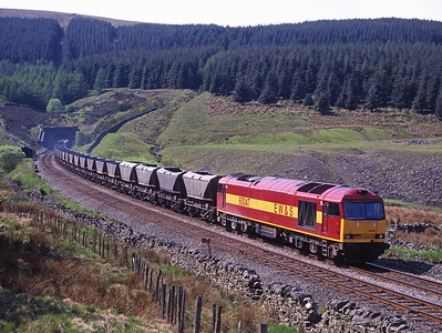 60047 leaves Blea Moor tunnel with coal empties on 16/5/98.