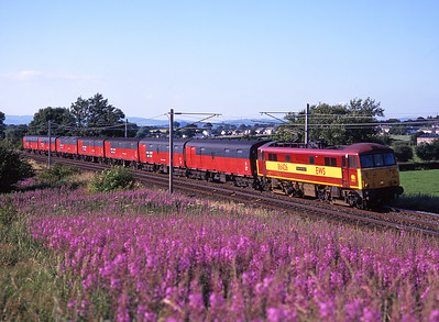 """86426 """"Pride of the Nation"""" passes the willow herb at Burton with 1V04 the Bristol mail train on 12/7/99."""