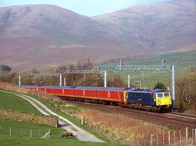 87002 hauls failed class 325 mail units past Lowgill 17/4/09.