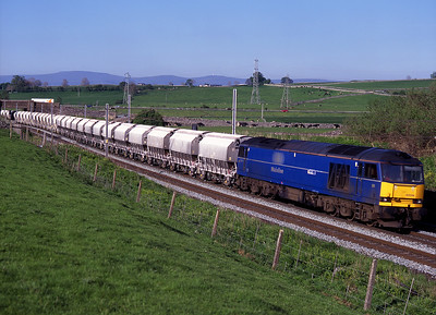 De-named 60044 passes Shap Beck with limestone empties for Hardendale on 18/5/99.