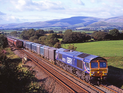 A near miss at Keld as 66723 hauls a southbound gypsum and passes northbound coal empties 8/9/07.
