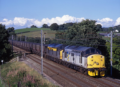 On bank holiday Monday 25/8/97 37519 + 37158 pass Sedgwick with a Knockshinnoch-Fiddlers Ferry MGR coal train...