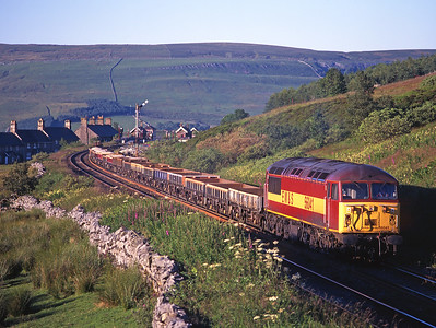 3 hours after photographing it at Milton, 56041 passes Garsdale with an engineers train on 11/7/99.