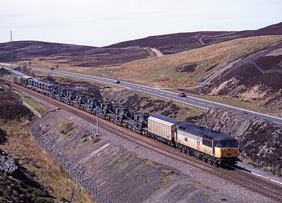 """56033 """"Shotton Paper Mill"""" crests Slochd summit with a military special, 11/5/98."""