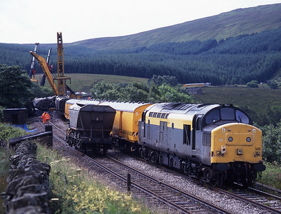 3 days after the Dent Head de-railment the wagons are being moved by cranes; breakdown trains hauled by 37146 and 60085 are in attendance, 17/7/98.