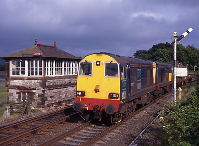 20307 + 20312 pass Arnside signal box with a flask from Heysham on 15/6/99.