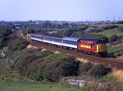 37418 passes Llanfairyneubwll with a train from Holyhead on 9/8/98.