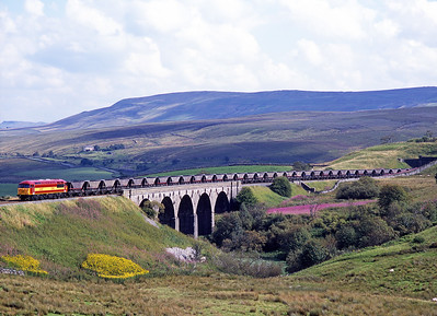Ex works 56087 crosses Lunds viaduct with coal empties on 26/8/97.