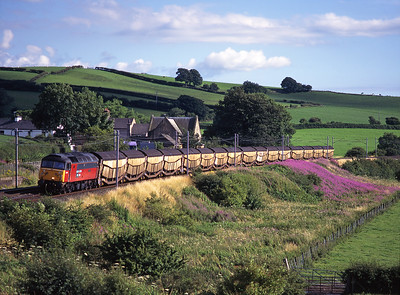 """47773 """"Reservist"""" passes Burton & Holme station with a car train on 22/7/99."""