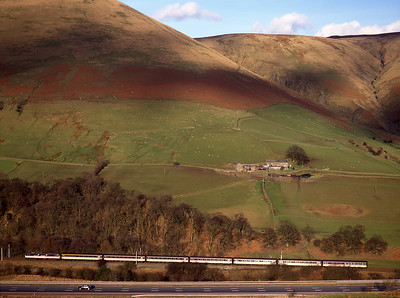 An unidentified 86 hauls a northbound cross country train through the Lune Gorge on 22/2/98.