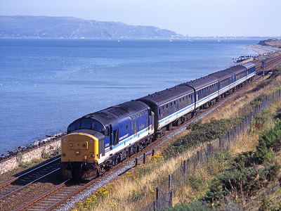 "37420 ""The Scottish Hosteller"" hauls a westbound train near Penmaenmawr on 9/8/98."