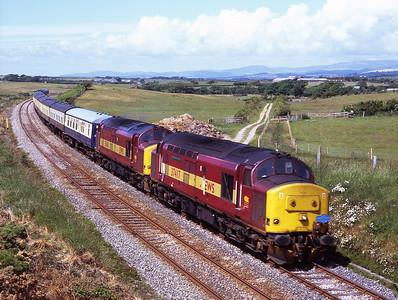 37417+37401 haul a Pathfinder Ravenglass-Cardiff charter near Bootle 14/6/08.